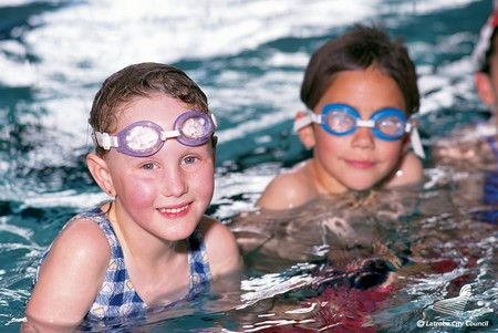 How to Help a Child Learning to Float and Swim Children learn Float