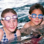 How to Help a Child Learning to Float and Swim
